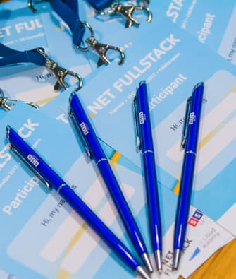 blue pens with logo of company